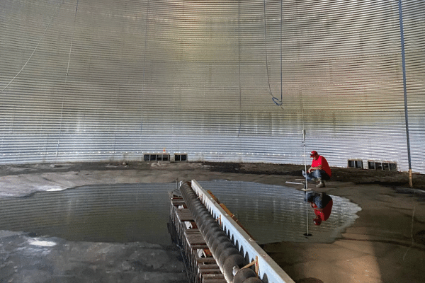 Water pooling inside the grain bin that is going to be repaired.